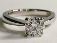 Diamond solitaire ring with thin band close to the central stone