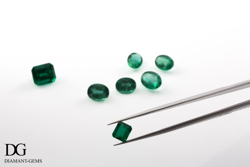observation of an emerald held with pliers