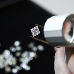 observation of a princess diamond with magnifying glass