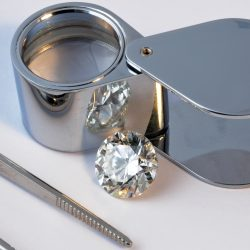 round diamond, pliers and magnifying glass